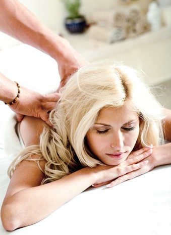 Acupuncture treatment with woman relaxing